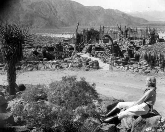 The Araby rock house called Casa Contenta. The woman is possibly Perle Wheeler Martin.