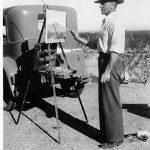Arnold Krug painting al fresco in the Arizona desert, circa 1940.