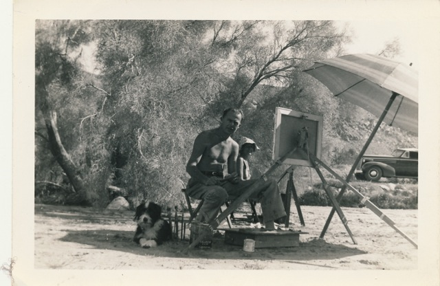 Procter and his dog Patches under a smoke tree.