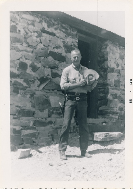 Burt Procter at the stone house, forever a cowboy.