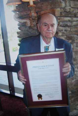 "Carl holding his ""Carl Bray Day"" Proclamation from the City of Indian Wells"