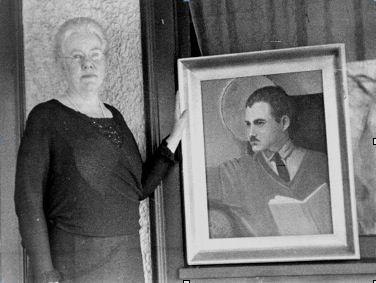 Grace Hall Hemingway with a painting she did of Ernest based on a Man Ray photo. Her choice of the almost saintly depiction of her son shows great pride in him and his accomplishments. Despite all the disparaging comments that Ernest later made about his mother, his choice of a painter as the occupation for the protagonist in one of his final novels may suggest his grudging admiration of her choice of painting for her late career.