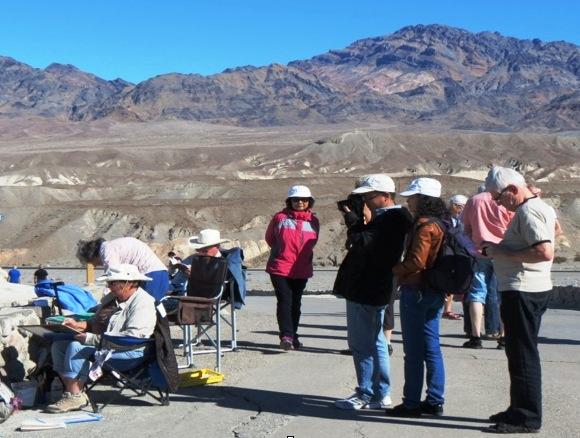 Tourists watch painters, photo by Jim Trolinger