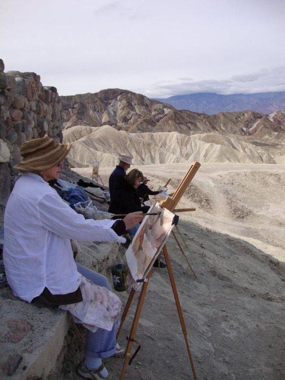 Artists at work at Zabriskie Point shielded by the viewing platform wall.