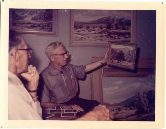 Roy Hubbell and Paul Grimm look at paintings