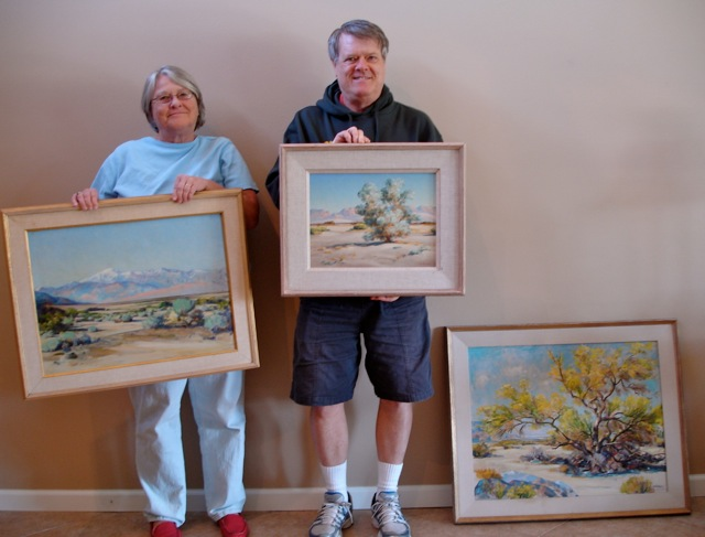 Susan Seymour and brother Tom Hollister with their family's Agnes pelton paintings.